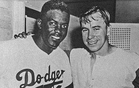 Dodger greats Jackie Robinson and Pee Wee Reese - when fans booed Robinson, Reese put his arm around him in an expression of Brotherhood. That small but significant gesture resounds to this day. Click Here To Learn More About Pee Wee Reese and his symbolic contribution to breaking down the racial barriers in Baseball.